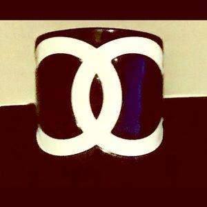 Coco Chanel black and white cuff bracelet.